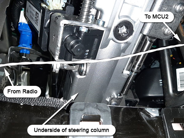Cable under steering column